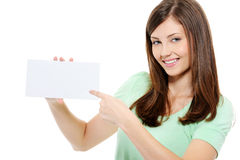 Young beauty woman pointing on the blank card Stock Photos