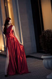 Young Beauty Woman In Red Dress Outdoor Stock Photos