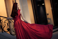 Young Beauty Woman In Red Dress Outdoor Stock Photo