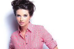 Young beauty woman in red shirt and nice hairstyle Stock Photography
