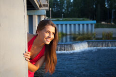Young beauty woman in red smile and look at sunset Stock Photo
