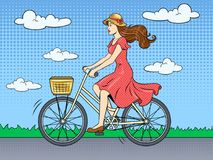Young woman ride on bicycle pop art vector. Young beauty woman ride bicycle pop art retro vector illustration. Color background. Comic book style imitation Stock Photos