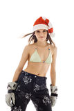 Young beauty woman in santa hat bikini sportswear Royalty Free Stock Photos