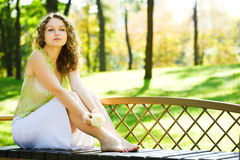 Young beauty woman sit on bench Royalty Free Stock Photo