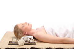 Young beauty woman in a spa with closed eyes Royalty Free Stock Photos