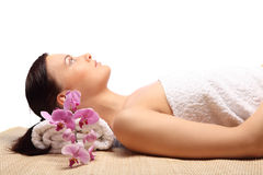 Young beauty woman in a spa with closed eyes Stock Photography