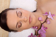 Young beauty woman in a spa with closed eyes Stock Photos