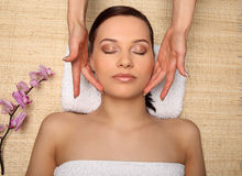 Young beauty woman in a spa with closed eyes Stock Photo