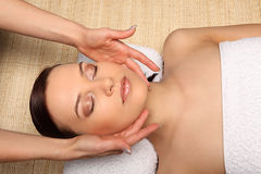 Young beauty woman in a spa with closed eyes Royalty Free Stock Photography