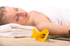 Young beauty woman in a spa with closed eyes Stock Image