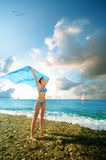 Young beauty woman stand on sea beach Stock Image