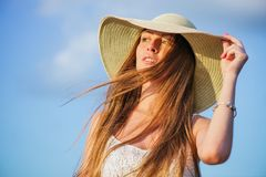 Young beauty woman in summer hat. Young smiling beauty woman in summer hat over sky. Half face shot Stock Image