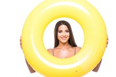 Young beauty Woman in swimsuit inside inflatable ring isolated over white background. Young beauty Woman in swimsuit inside inflatable ring isolated over white royalty free stock photos