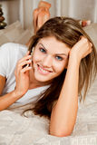 Young beauty woman telephoning. Young beauty woman couch in the bed and telephoning Royalty Free Stock Images