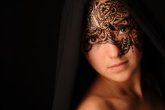 Young beauty woman with tracery on the face Royalty Free Stock Photos