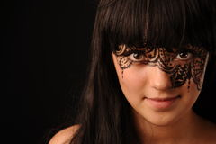 Young beauty woman with tracery on the face Stock Photography