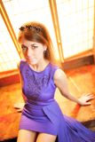 Young beauty woman in violet dress Royalty Free Stock Images
