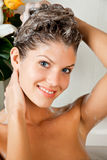Young beauty woman washing her hair royalty free stock photography