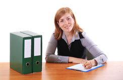 Young beauty woman writing at table in office Stock Images