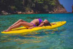 Young beautyful girl on the SUP board Stock Image