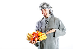 Young bedouin. Man in traditional dress with fruit Royalty Free Stock Photo