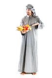 Young bedouin. Man in traditional dress with fruit Royalty Free Stock Images