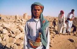 Young bedouin. The portrait of a Young bedouin at baraqish in the desert of yemen stock image