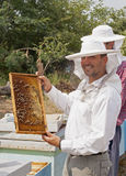 Young beekeepers. Working at field and smiling Royalty Free Stock Photos