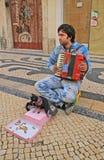 Young beggar musician, Lisbon, Portugal Stock Photo