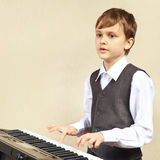 Young beginner pianist play the keys of synthesizer Royalty Free Stock Photos