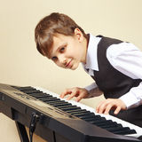 Young beginner pianist in suit playing the electronic piano Royalty Free Stock Photography