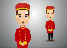 Young bellhop waiting for the clients Royalty Free Stock Photo