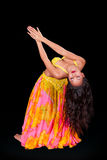 Young belly dancer in backbend to right. A young belly dancer  is seen from the front performing a backbend to the right Royalty Free Stock Photos