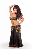Young belly dancer in black costume Royalty Free Stock Image