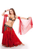 Young belly dancer in dance pose Royalty Free Stock Photos