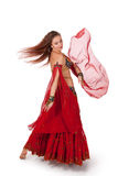 Young belly dancer dancing a turn Royalty Free Stock Image