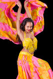 Young belly dancer dancing with veils. A young belly dancer  dances with her veil flying behind her Stock Photography