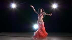 Young belly dancer girl dancing exotic on black stock video footage