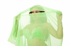 Young belly dancer in green veil Royalty Free Stock Photo