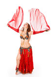 Young belly dancer in motion Stock Photo