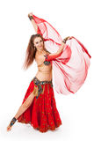 Young belly dancer in motion. A young belly dancer  strikes a pose during her dance Royalty Free Stock Images