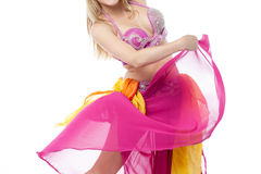 Young belly dancer performing. Professional belly dancer in colourful costume Royalty Free Stock Image