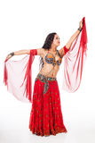 Young belly dancer  reaching in red costume Stock Image