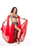Young belly dancer  in red costume Stock Image