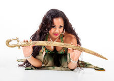 Young belly dancer  with sword Royalty Free Stock Photo