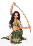 Young belly dancer  with sword. A beautiful young belly dancer pulls a sword out of the scabbard Stock Photography