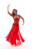 Young belly dancer in a turn Stock Photo