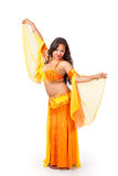 Young belly dancer in yellow and orange costume Stock Photography