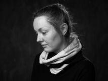 Young  bemused disoriented woman. Portrait of a young sad disoriented woman, side view grey background Stock Images