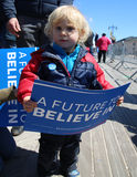 Young Bernie Sanders supporter during presidential candidate Bernie Sanders rally  at iconic Coney Island boardwalk Royalty Free Stock Image